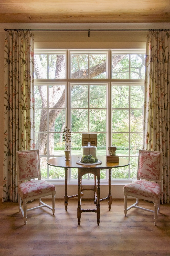 Bay window at Cliffbrook features feminine window treatments. Curated by Kristin Mullen