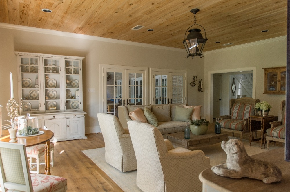 Family room with tongue and groove ceiling and a family-friendly seating arrangement that functions perfectly for more formal gatherings as well. Curated by Kristin Mullen