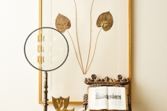 Vignette with botanical artwork and layered accessories. Interiors - Curated by Kristin Mullen.