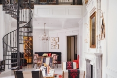 Interior Design - Curated by Kristin Mullen, this space features neoclassical design, red accents, a custom wine cellar and multiple seating arrangements.