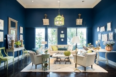 Overall shot of the Kristin Mullen Designs vignette for Thrift Studio 2018 benefitting Dwell With Dignity. This room features a rich blue paint color, garden inspired accents and lime green touches.