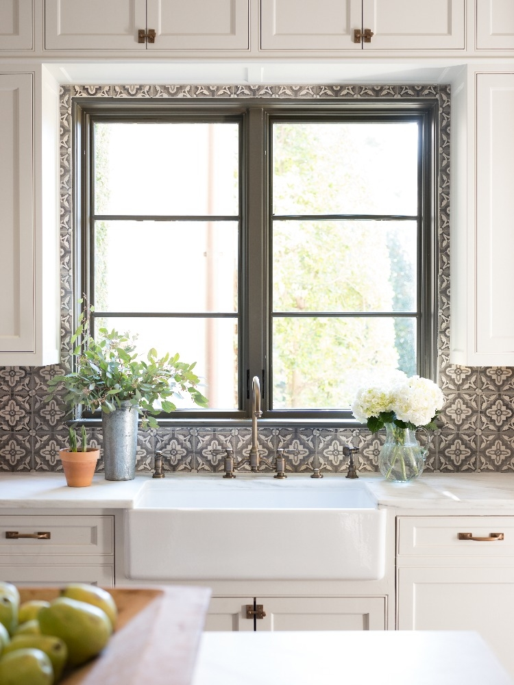 Modern Mediterranean kitchen features a practical farm sink and plenty of natural light. Curated by Kristin Mullen and Photography by Marc Montoya of Billy Surface