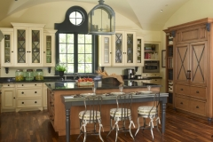 Meadowood Project kitchen is kid-friendly, French country inspired and perfect for the chef of the house! My favorite accents are the faux bookshelves on either side of the refrigerator, they extend into a full pantry! Curated by Kristin Mullen