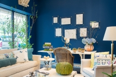 Detail shot of the Kristin Mullen Designs vignette for Thrift Studio 2018 benefitting Dwell With Dignity. This room features a rich blue paint color, garden inspired accents and lime green touches.
